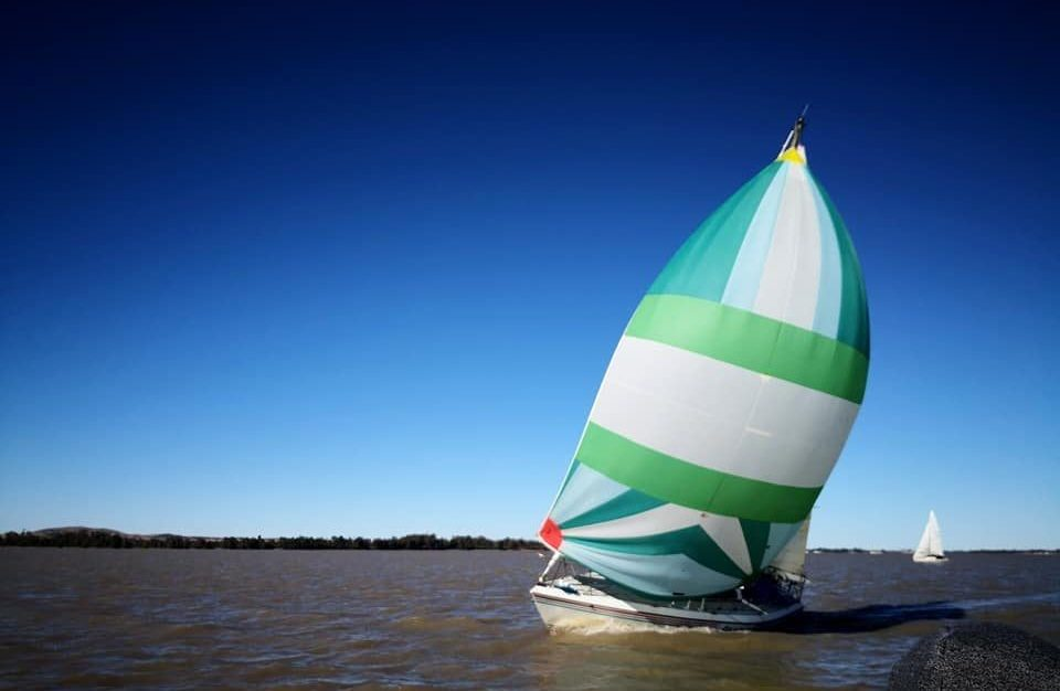 Picture of sailboat with green sails